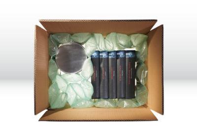 Kartonage mit Luftpolsterverpackung der Tillmann Verpackungen Schmalkalden GmbH als Hohlraumfüllung beim Versenden mehrerer Waren