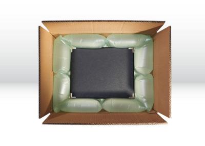 Kartonage mit großen Luftpolsterkissen der Tillmann Verpackungen Schmalkalden GmbH als Kantenschutz zum allseitigen Umschließen der zu transportierenden Waren