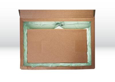Kartonage mit Luftpolsterkissen der Tillmann Verpackungen Schmalkalden GmbH als Oberflächenschutz
